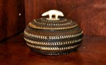 Artist: Attributed to Kinguktuk Baleen Whale Basket with Ivory Wolf (Eskimo) Value: $7,500